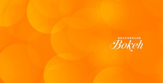 Aantrekkelijke oranje bokeh banner met tekstruimte Gratis Vector
