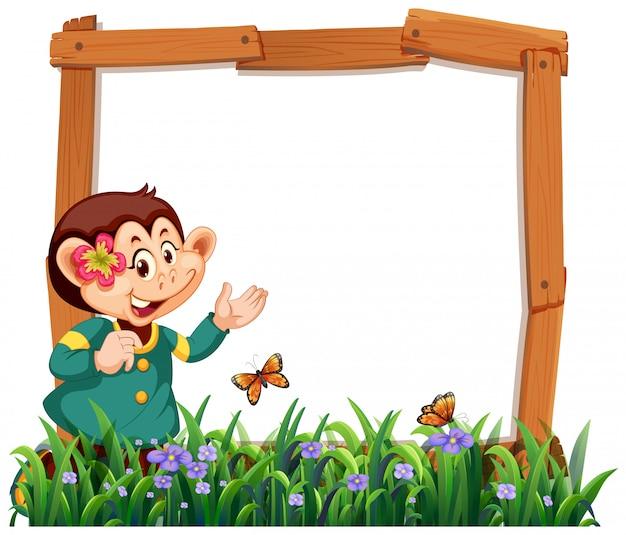 Aapkader in aard met gras en vlinders Gratis Vector