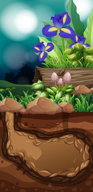 Aardscène met bloemen en paddestoel Gratis Vector