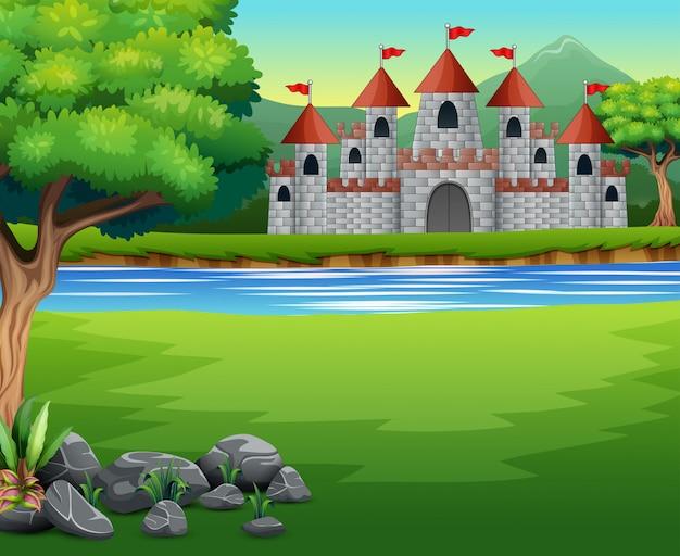 Aardscène met kasteel en een vijver Premium Vector