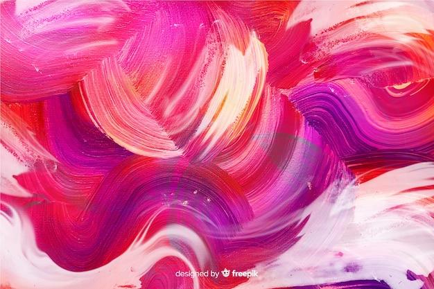 Abstract geschilderde penseelstreken achtergrond Gratis Vector