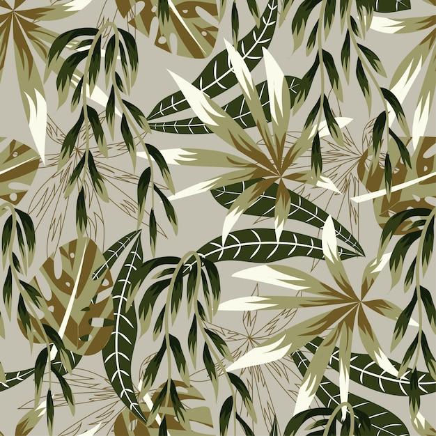 Abstract helder naadloos patroon met kleurrijke tropische bladeren en installaties op beige Premium Vector