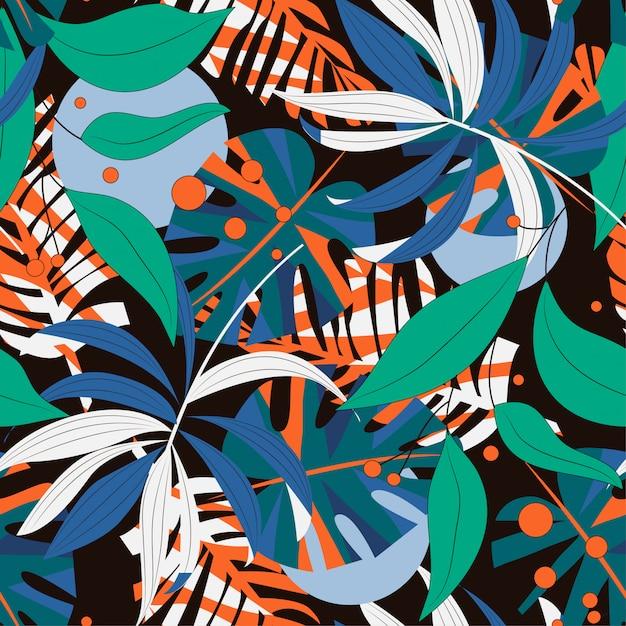 Abstract naadloos patroon met kleurrijke tropische bladeren en installaties op donkere achtergrond Premium Vector