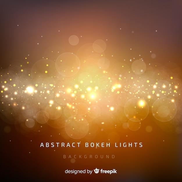 Abstracte bokeh lichtenachtergrond Gratis Vector