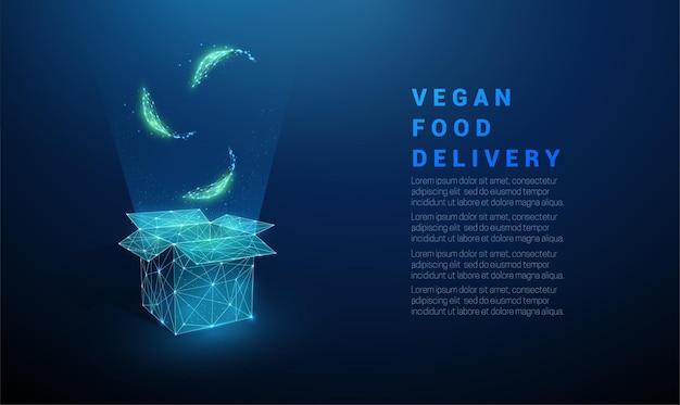Abstracte groene bladeren vallen in open doos. veganistisch eten symbool. laag poly-stijl ontwerp. Premium Vector