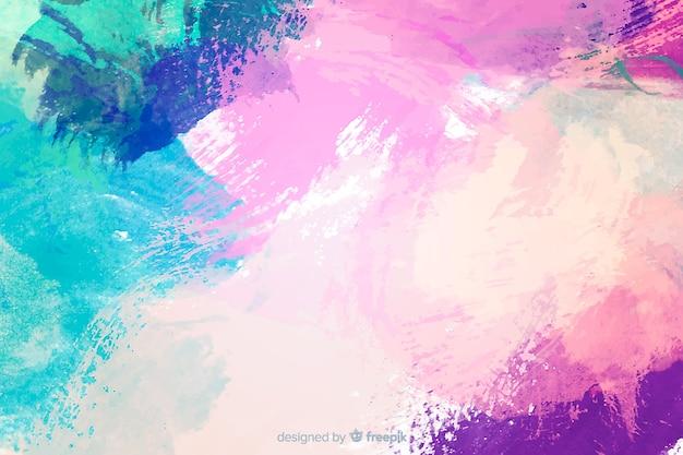 Abstracte kleurrijke aquarel vlek achtergrond Gratis Vector