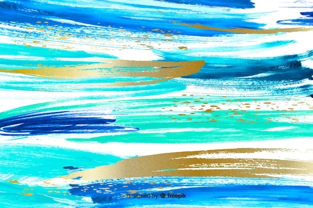 Abstracte penseelstreken achtergrond Gratis Vector