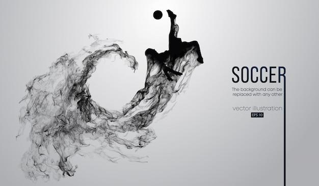 Abstracte silhouet van een voetballer op donkere zwarte achtergrond van deeltjes. voetbalspeler lopen springen met bal. wereld- en europese competitie. Premium Vector