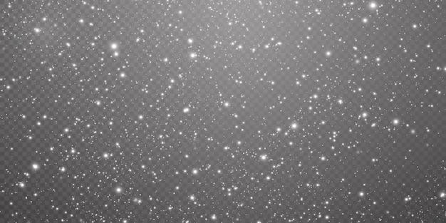 Abstracte winter achtergrond van sneeuwvlokken geblazen door de wind op een witte transparante achtergrond. Premium Vector