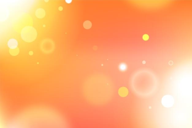 Achtergrond met kleurovergang met bokeh-effect Gratis Vector
