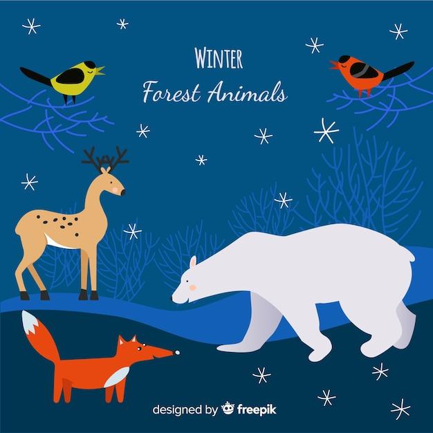Achtergrond van de winter de hand getrokken bosdieren Gratis Vector