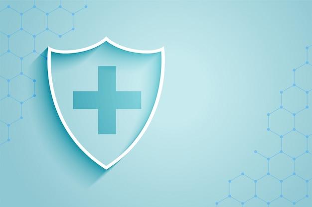 Achtergrond van het gezondheidszorg de medische schild met tekstruimte Gratis Vector