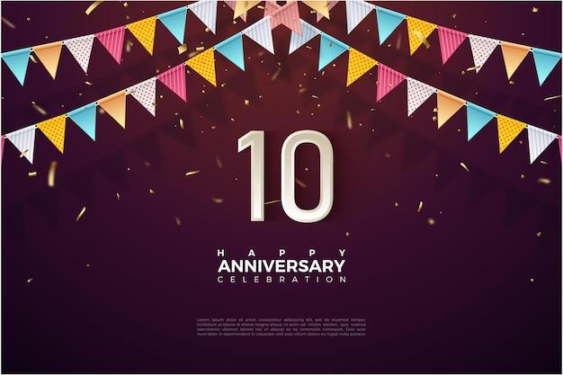 Achtergrond voor 10e verjaardag met kleurrijke vlag bovenop getallen Premium Vector