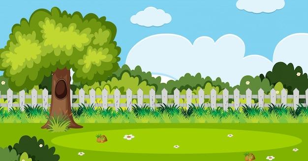Achtergrondscène met boom en witte omheining in tuin Premium Vector
