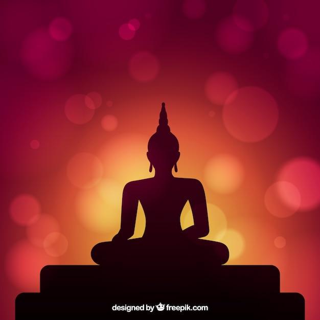 Achtergrondsilhouet van het standbeeld van boedha Gratis Vector