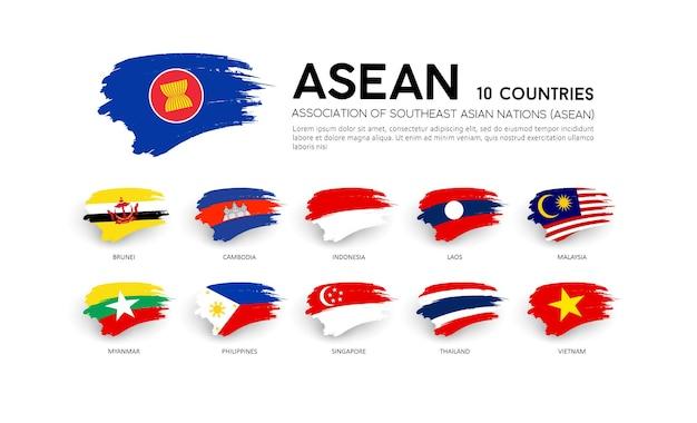 Aec asean economische gemeenschap vlaggen, penseelstreek Premium Vector