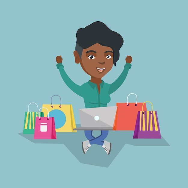 Afrikaanse vrouw die laptop voor online het winkelen gebruikt Premium Vector