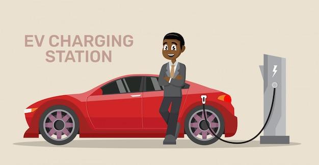 Afrikaanse zakenman elektrische auto opladen. Premium Vector