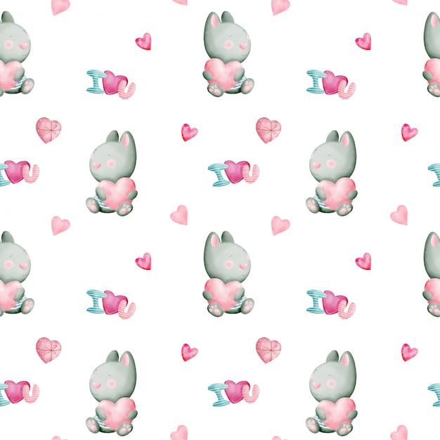 Aftelkalender voor valentijnsdag aquarel naadloze patroon met konijnen en harten Premium Vector