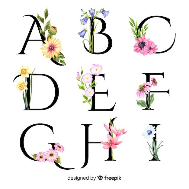 Alfabet met realistische bloemen Gratis Vector