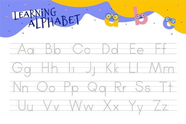 Alfabet overtrekwerkblad met illustraties Gratis Vector