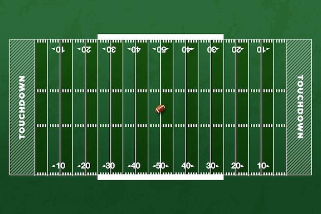 Amerikaans voetbalveld en rugbybal in het midden Gratis Vector