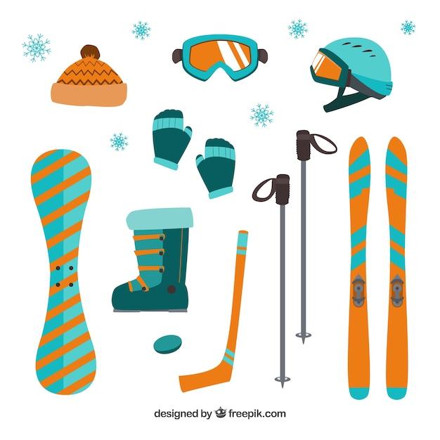 Apparatuur voor de wintersport in plat design Gratis Vector