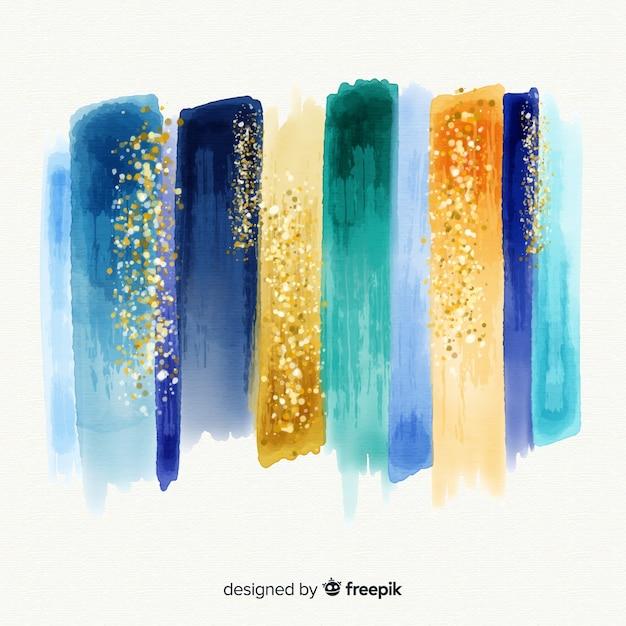 Aquarelstreken met glitter Gratis Vector