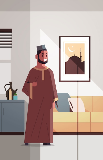 Arabische man in traditionele kleding vieren ramadan kareem heilige maand moderne woonkamer interieur plat verticale volledige lengte Premium Vector