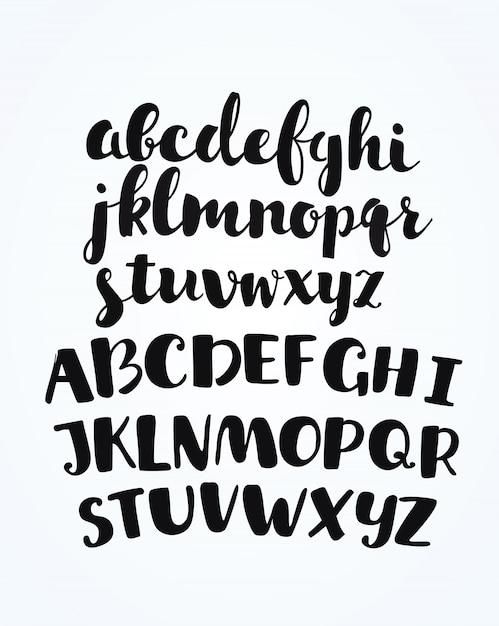 Artistieke handgetekende gouden lettertype. alle letters zijn geschilderd in gouden textuur. cursief, vetgedrukt. illustratie. Premium Vector