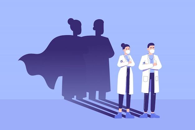Artsen die vol vertrouwen staan en superheldenschaduw verschijnen achter op de muur Premium Vector