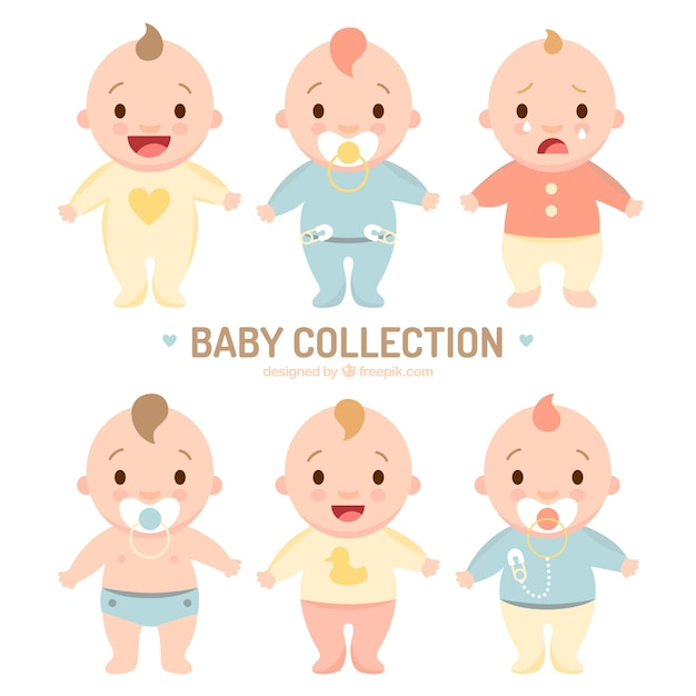 Assortiment van schattige baby's in pyjama Premium Vector
