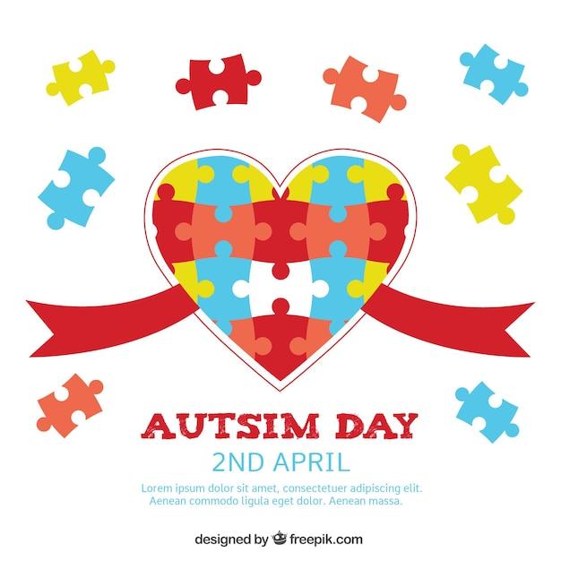 Autisme dag achtergrond met hart en puzzelstukjes Gratis Vector