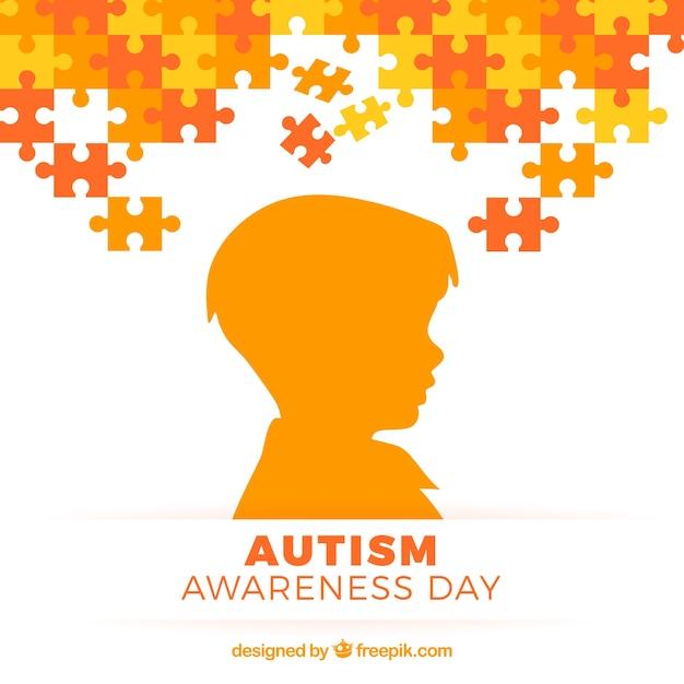 Autisme dag achtergrond met kind silhouet Gratis Vector