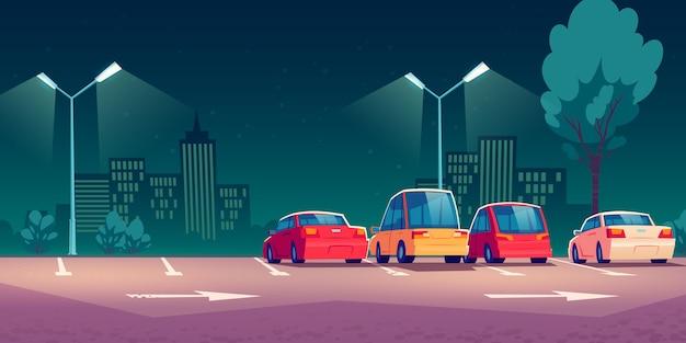 Auto's op stadsstraat parkeren bij nacht Gratis Vector