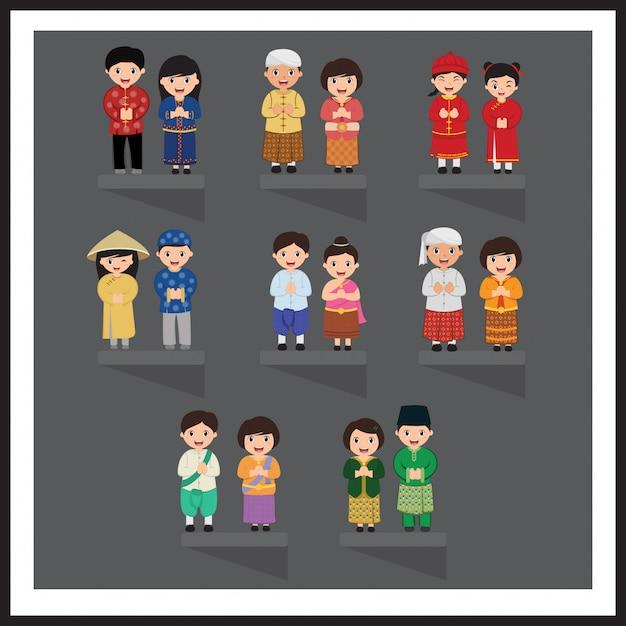 Aziaat in nationale kleding. zuid-oost azië. set stripfiguren in klederdracht. Premium Vector