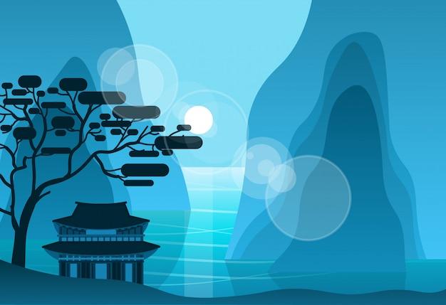 Aziatische tempel in bergen in de nacht op achtergrond silhouet pagode landschap Premium Vector