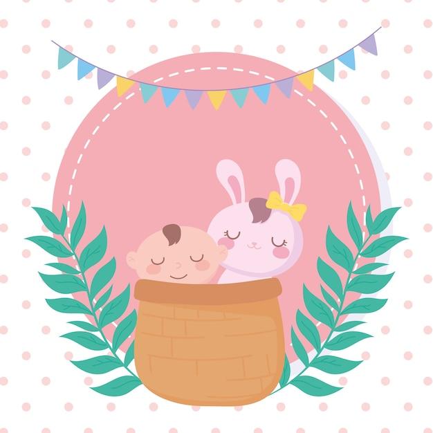 Babydouche, kleine jongen en konijn in mand, pasgeboren viering welkom Premium Vector