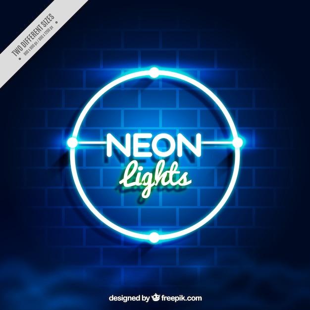 Bakstenen muur achtergrond met neon cirkel Gratis Vector