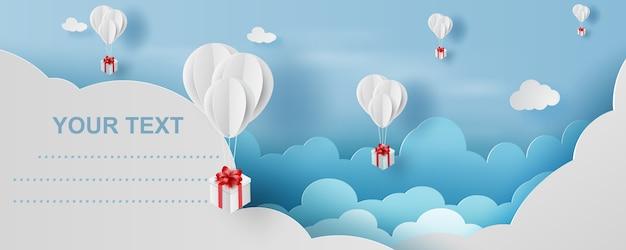 Ballon geschenkdoos in blauwe lucht lucht. Premium Vector