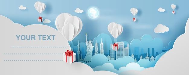 Ballon geschenkdoos op stad in new york Premium Vector