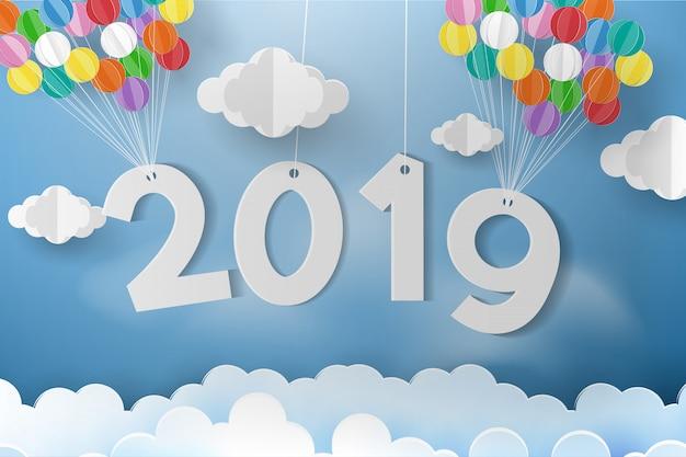 Ballon over wolk met groetkaart en nieuw jaar. Premium Vector