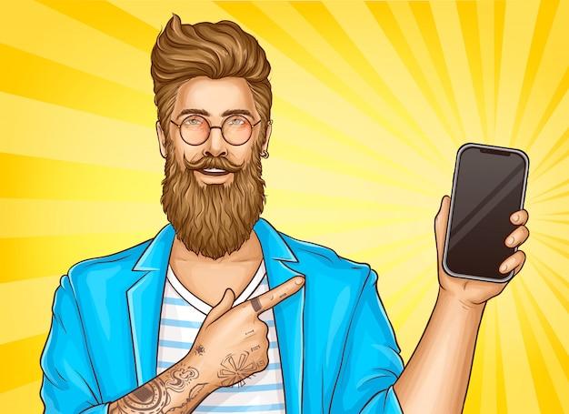 Bebaarde hipster met tatoeages wijzen op smartphone Gratis Vector