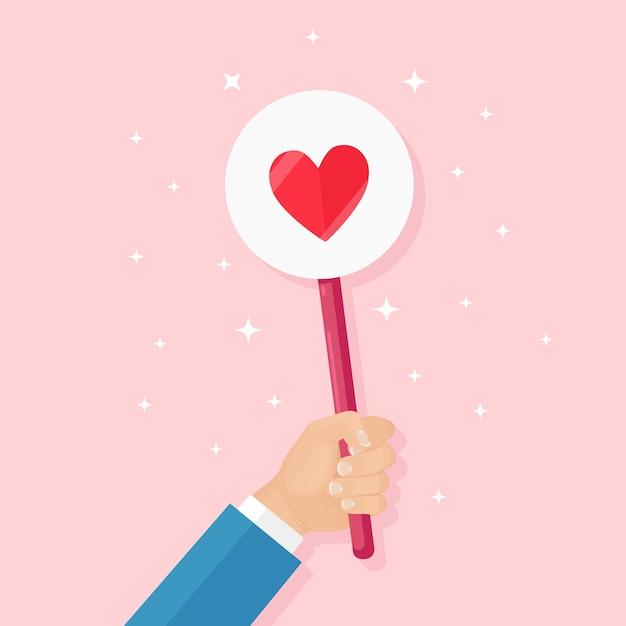 Bedrijfsmens met rood hartaanplakbiljet. sociale media, netwerk. goede mening. getuigenissen, feedback, klantrecensies, zoals concept. valentijnsdag. Premium Vector