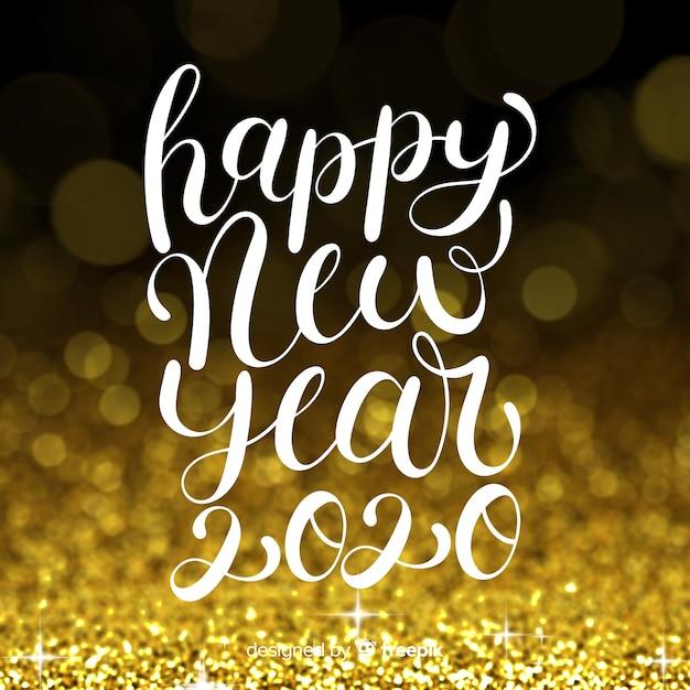 Belettering gelukkig nieuwjaar 2020 Gratis Vector