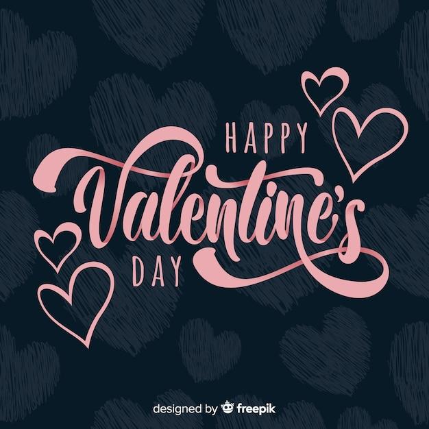 Belettering valentijnsdag achtergrond Gratis Vector