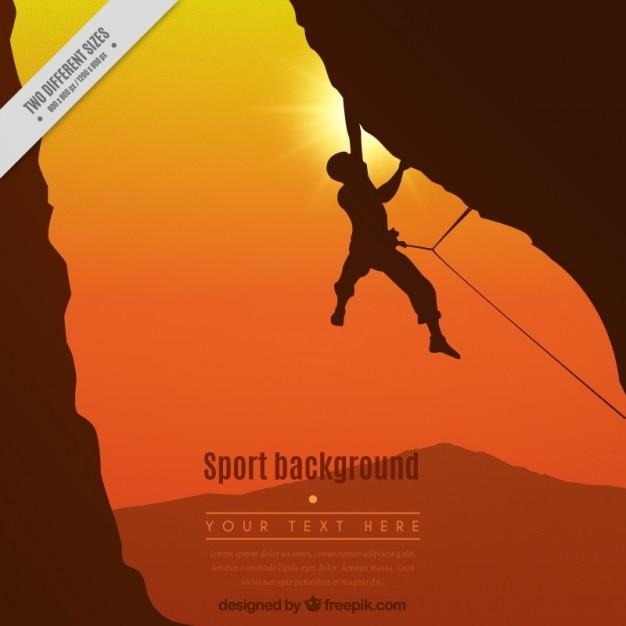 Bergbeklimmer in een zonsondergang op de achtergrond Gratis Vector