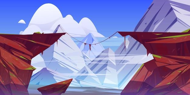 Berglandschap met afgrond in rotsen en sneeuwtoppen. Gratis Vector