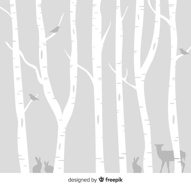 Besneeuwde bos achtergrond Gratis Vector