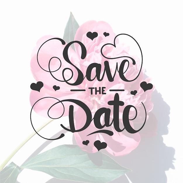 Bewaar de datum belettering met roos foto Gratis Vector